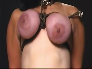 Chubby with big tits gets them tied up and abused painfully