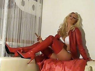 Hot Babe In Red Leather and Boots Smoking and Teasing