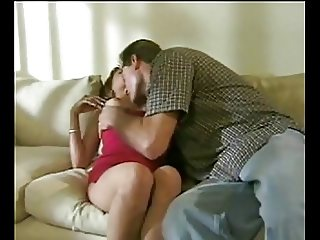 Young brunette gets seduced on the couch and takes it in the ass