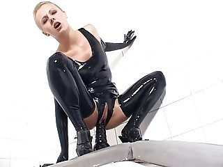 Girl in Latex plays with rubber toys and gives a blowjob.