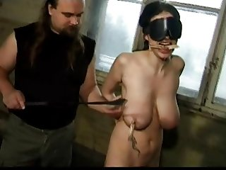 Big Titted Brunette gets tortured