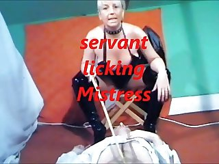 servant stooge licking Mistress
