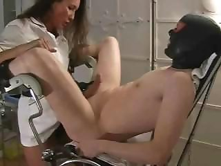 Nasty female doctor experiments with shy guy\'s enormous boner