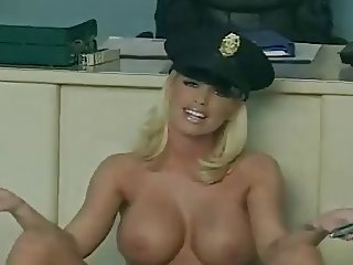 Police officer masturbating with toy.