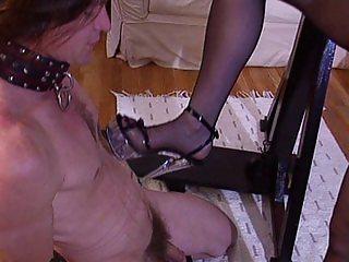 Redhead latex mistress hitting her slave