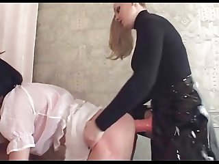 Domina fucks crossdresser with strapon