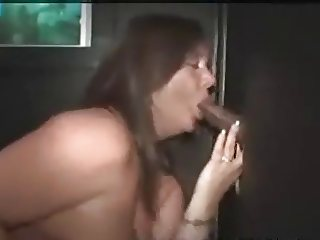 BBW whore sucks and fucks a BBC at the gloryhole
