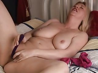 Beautiful blonde milf stimulates her clit in solo