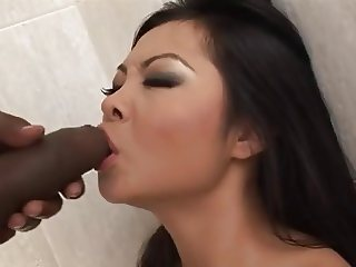 Asian tastes a black dick in the bathroom