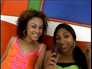 Two cute black hotties kissing and fondling their tits on couch
