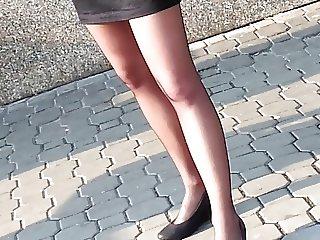 Sheer black pantyhose and short skirt.