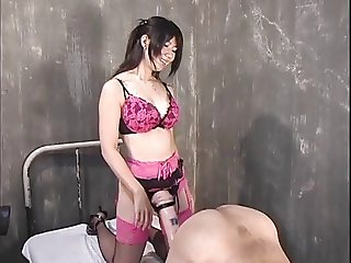 Japanese Mistress uses giant strapon on guy (censored)