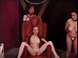 Slutty redhead is tortured by two older doms