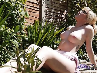 Exhibitionist Blonde Sunbathes Topless By Her Bush - Trailer