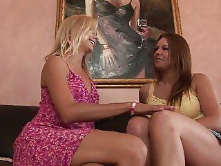 Brunette MILF gets fucked by blonde slut using a toy