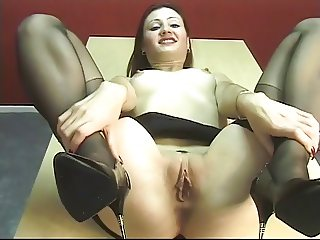 Sexy brunette secretary spreads her juicy pink pussy