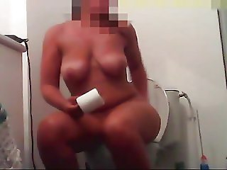 voyeur girl with big tits in the toilet