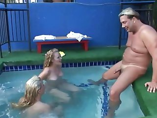 Eager MILF whores suck guy's dick in the pool