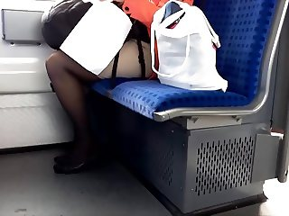 Candid nylon mature in train