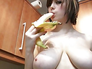 Louisa sucks off a banana wearing yellow lingerie in the kitchen