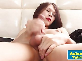 Adorable asian tgirl tugging away in solo fun