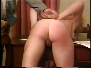 Businessman spanking slut's ass in the office