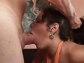 Busty MILF licks cum after stud fucks her hardcore