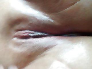 Rubbing oil on girlfriends pussy