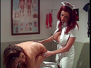 Redhead nurse gives patient an clieaning