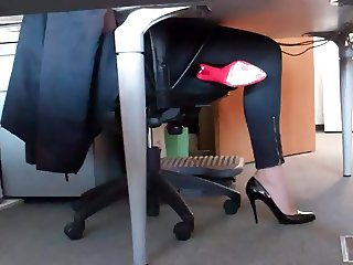 dangling her louboutin under desk 5
