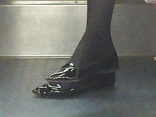 Beautiful feet in shoes high heels in train 12