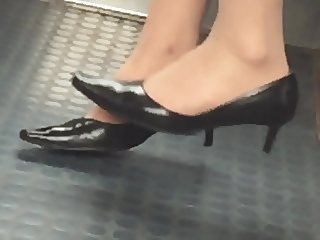 Beautiful feet in shoes high heels in train 11