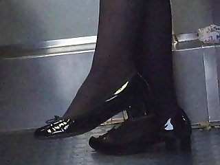 Beautiful feet in shoes high heels in train 10