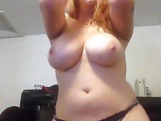 Curvy redhead dances