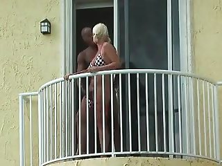 couple fuck on balcony