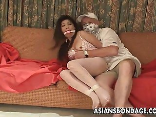 Asian slut is getting roped up and treated to a bdsm session