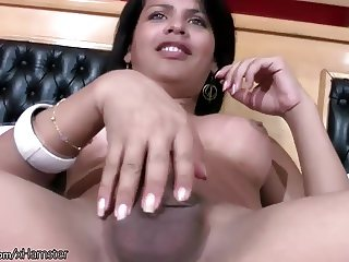 Latina tgirl in sexy black dress and heels masturbates