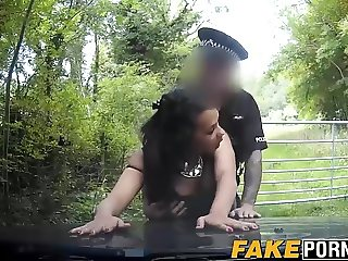Horny ebony chick fucking with the cop in the woods