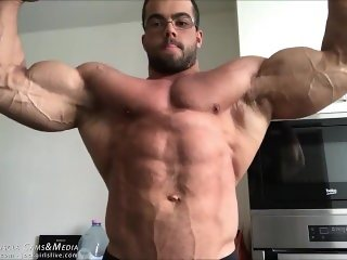 Bodybuilder Posing for Muscle Worship Session. Sorry - Totally SFW.