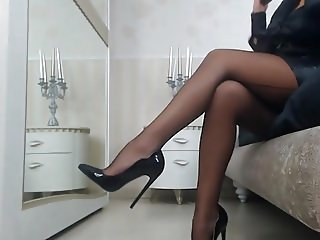 CELIA in a webcam show, all in black