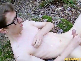 Horny dude in glasses strips and jacks off his cock outdoors