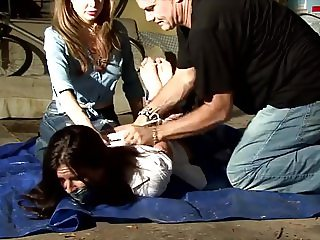 Women hogtied and gagged in Garage