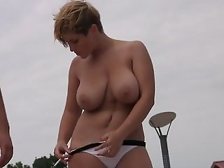 Women with huge tits topless on the beach 3