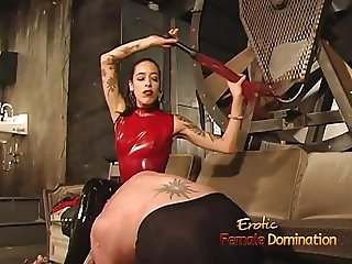 Stunning brunette hussy has her boots licked before whipping