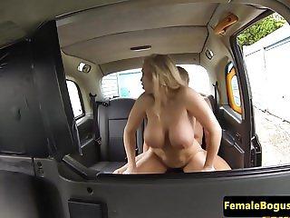 Busty british cabbie cockriding backseat guy
