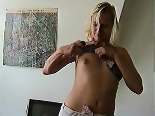 Blonde Amateur girl flashing her small Tits at Home