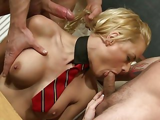 Wavy haired slut in a staw hat sits on a cock and gives blowy at the same time