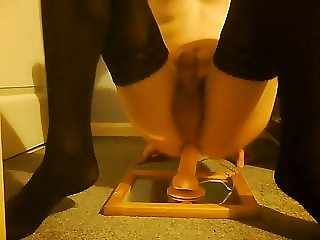 Crossdresser in stockings rides dildo