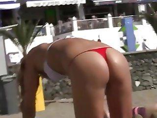 Gorgeous girl with thong bikini on beach